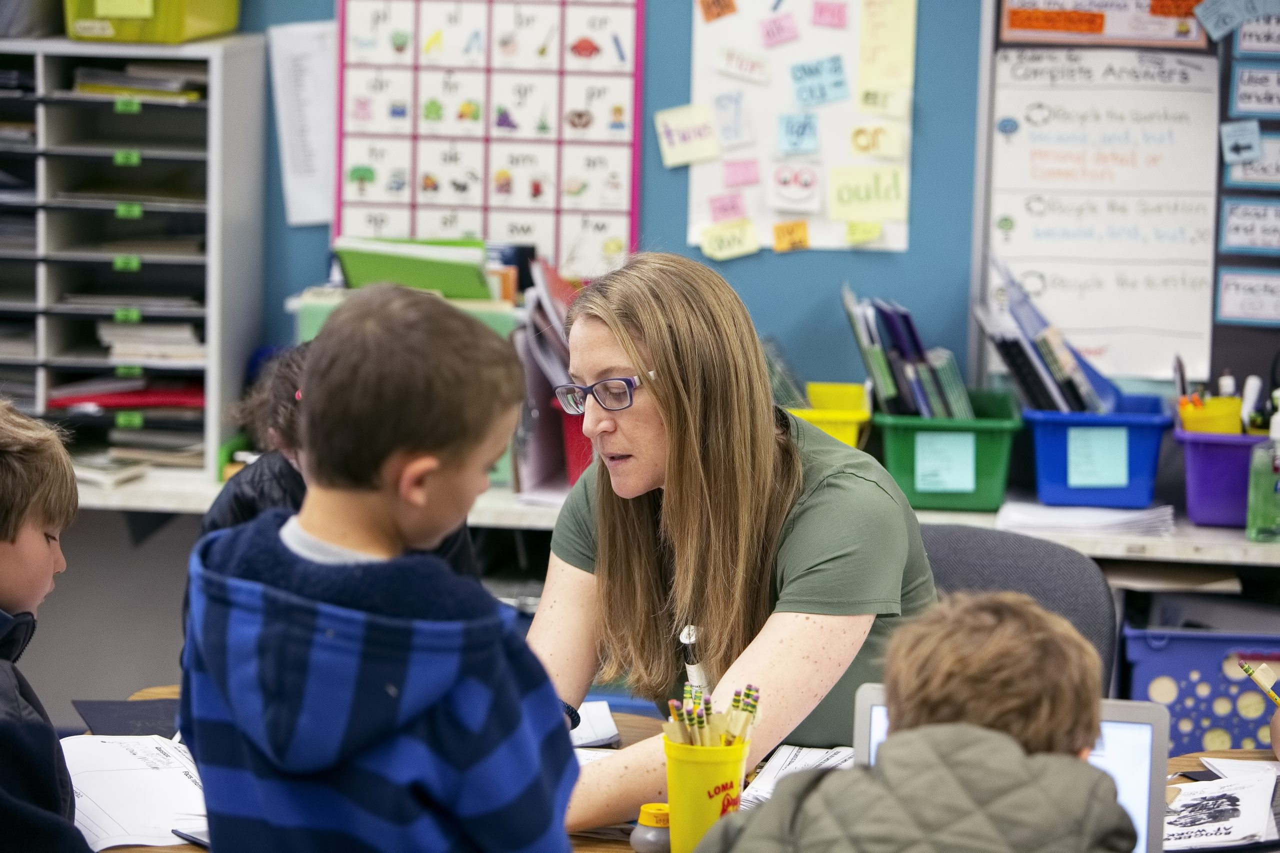 Female teacher working with small group of students